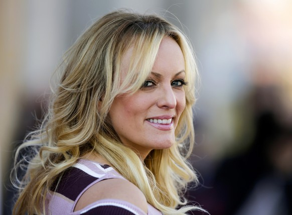 FILE - In this Oct. 11, 2018, file photo, adult film actress Stormy Daniels attends the opening of the adult entertainment fair