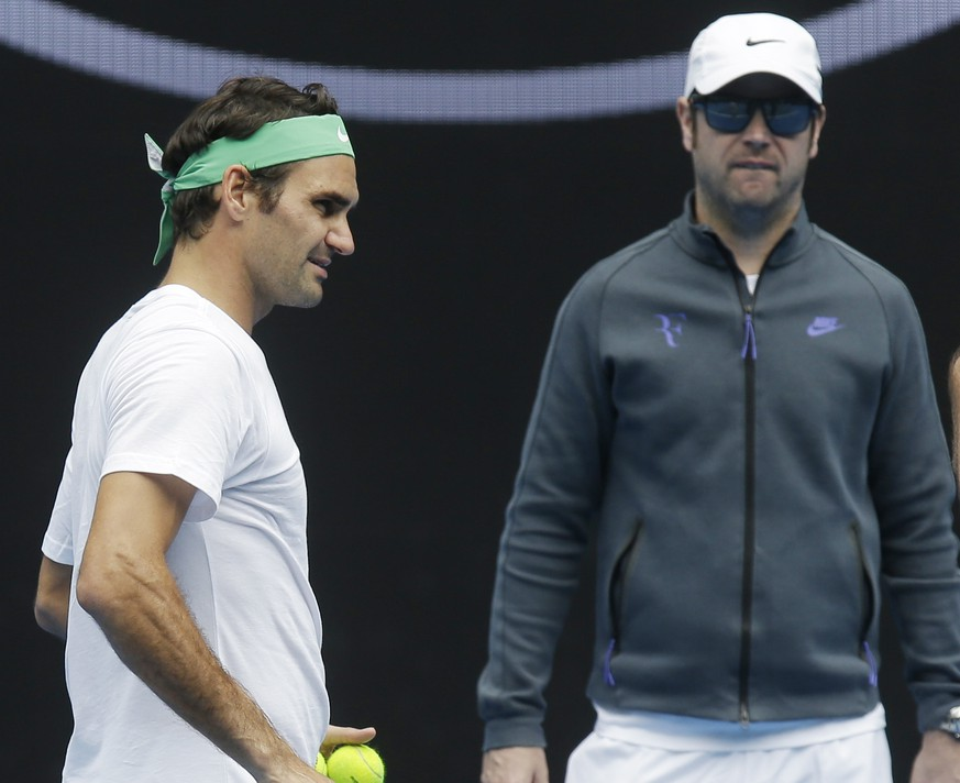 Switzerland's Roger Federer, left, talks with his coaches Ivan Ljubicic right, and Severin Luthi during a practice session ahead of the Australian Open tennis championships in Melbourne, Australia, Friday, Jan. 15, 2016.(AP Photo/Mark Baker)