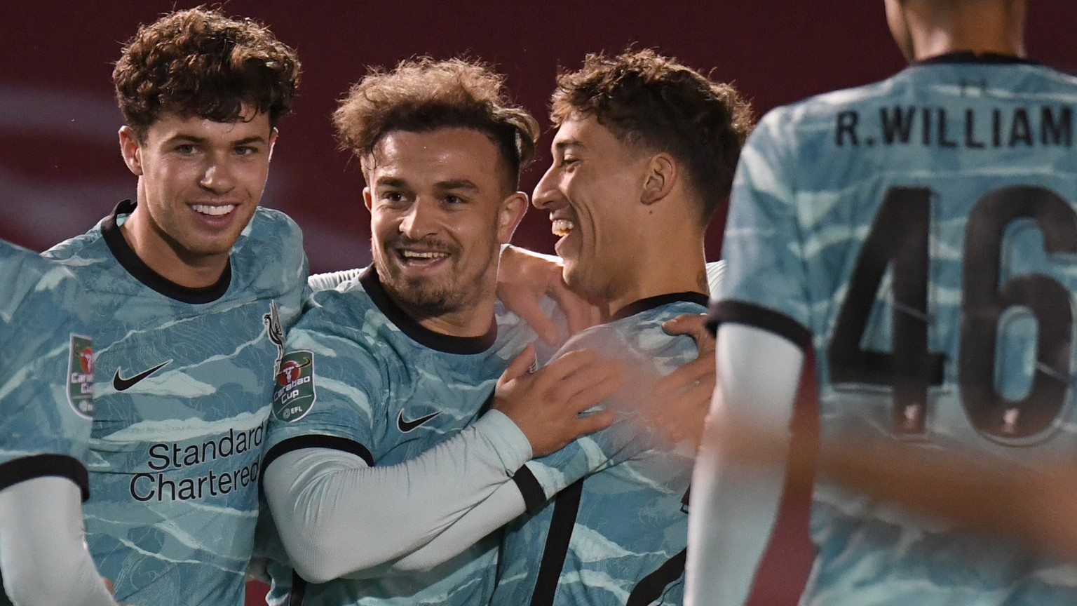 Liverpool's Xherdan Shaqiri, at centre, celebrates with teammates after scoring the opening goal of the game during the English League Cup third round soccer match between Lincoln City and Liverpool at the LNER stadium, Lincoln, England, Thursday, Sept. 24, 2020. (Peter Powell, Pool via AP)