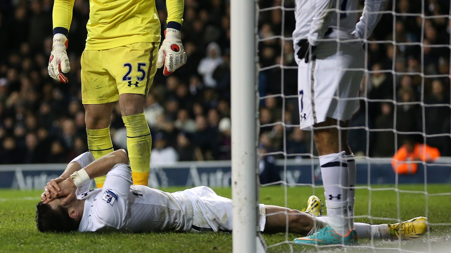 LONDON, ENGLAND - NOVEMBER 28: Hugo Lloris of Tottenham Hotspur looks to Gareth Bale of Tottenham Hotspur who lies on the floor after scoring an own goal during the Barclays Premier League match between Tottenham Hotspur and Liverpool at White Hart Lane on November 28, 2012 in London, England.  (Photo by Julian Finney/Getty Images)