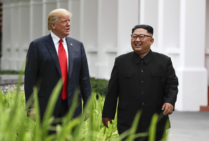 FILE - In this June 12, 2018, file photo, U.S. President Donald Trump, left, and North Korea leader Kim Jong Un walk from their lunch at the Capella resort on Sentosa Island in Singapore. The most sensational of Kim's trip was the summit in Singapore with Trump. (AP Photo/Evan Vucci, File)