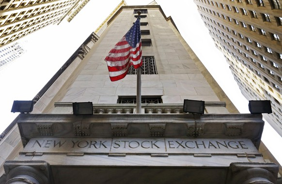 FILE - In this Friday, Nov. 13, 2015, file photo, an American flag flies above the Wall Street entrance to the New York Stock Exchange. Intercontinental Exchange Inc. is considering a bid for the London Stock Exchange, looking to potentially thwart its merger talks with Deutsche Boerse. ICE, the owner of the New York Stock Exchange, said Tuesday, March 1, 2016, that it has yet to decide whether to pursue an offer and hasn't reached out to LSE's board. (AP Photo/Richard Drew, File)