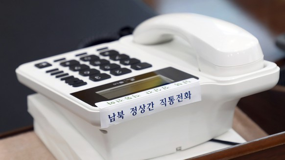 This photo provided by South Korea Presidential Blue House via Yonhap News Agency, shows a telephone hotline between South Korea and North Korea at the presidential Blue House in Seoul, South Korea, Friday, April 20, 2018. North and South Korea installed a telephone hotline between their leaders Friday as they prepare for a rare summit next week aimed at resolving the nuclear standoff with Pyongyang. The Koreans read