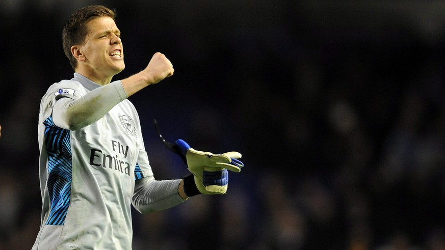 epa03154161 Wojciech Szczesny goalkeeper for Arsenal celebrates at the end of the English Premier League soccer match at Goodison Park in Liverpool, Britain, 21 March 2012.  EPA/PETER POWELL DataCo terms and conditions apply. http//www.epa.eu/downloads/DataCo-TCs.pdf