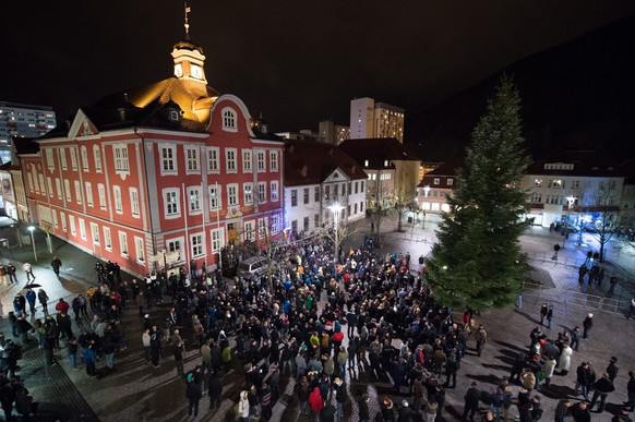 epa04557414 Participants in a Suegida (Southern Thuringia against the Islamization of the West) rally at the market place in Suhl, Germany, 12 January 2015. Suegida is the first Pegida (Patriotic Europeans against the Islamization of the West) branch in Thuringia. Islam is part of German life, Chancellor Angela Merkel said 12 January 2015, even as a group of anti-Islam and anti-refugee protesters geared up for controversial marches that have become a weekly fixture in the eastern city of Dresden.  EPA/SEBASTIAN KAHNERT
