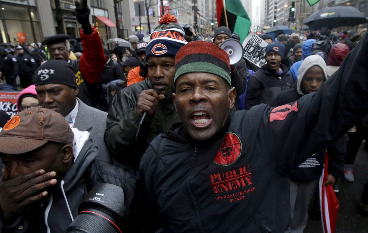 Protesters make their way up North Michigan Avenue on Friday, Nov. 27, 2015, in Chicago. Community activists and labor leaders hold a demonstration billed as a