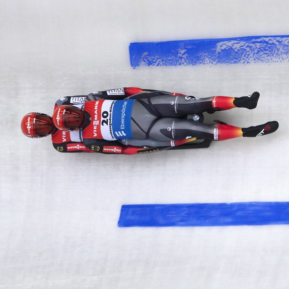 epa08258294 Tobias Wendl and Tobias Arlt of Germany in action during the first run of the men's doubles competition for the Luge World Cup in Schoenau am Koenigssee, Germany, 29 February 2020.  EPA/ANDREAS SCHAAD