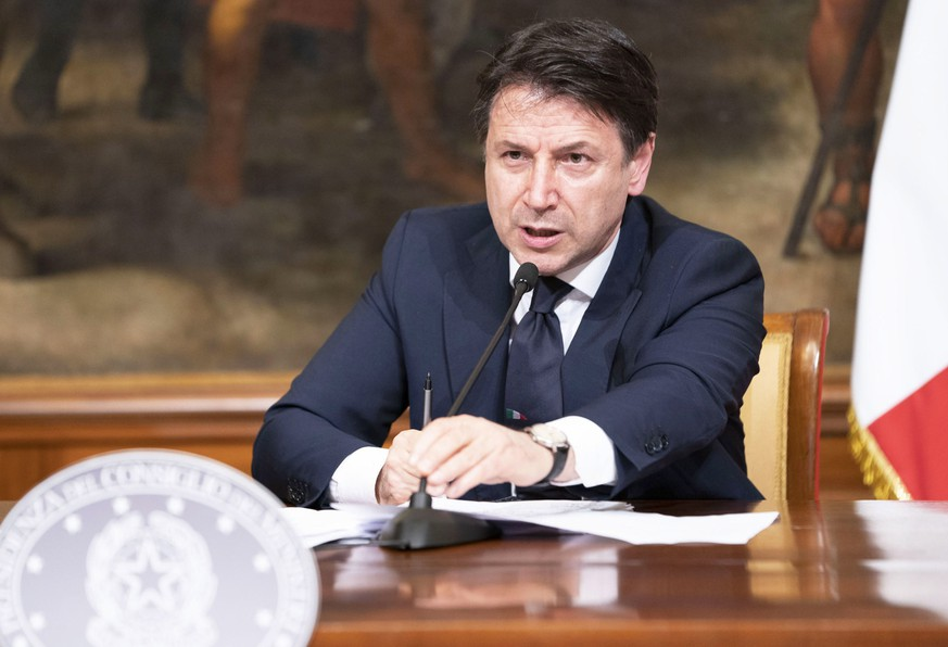 epa08346775 A handout photo made available by the Chigi Palace Press Office shows Italian Prime Minister Giuseppe Conte attending a press conference at the end of a Cabinet meeting on the coronavirus pandemic at Chigi Palace in Rome, Italy, 06 April 2020. Countries around the world implemented measures to stem the widespread of the SARS-CoV-2 coronavirus that causes the COVID-19 disease.  EPA/CHIGI PALACE PRESS OFFICE / FILIPPO ATTILI / HANDOUT  HANDOUT EDITORIAL USE ONLY/NO SALES