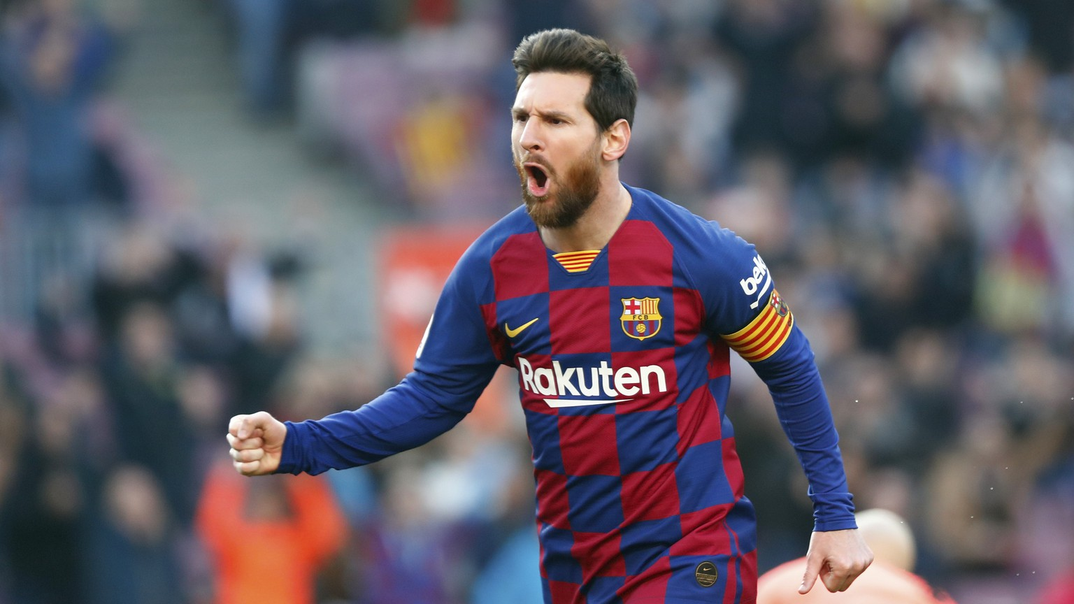Barcelona's Lionel Messi celebrates after scoring his side's opening goal during a Spanish La Liga soccer match between Barcelona and Eibar at the Camp Nou stadium in Barcelona, Spain, Saturday Feb. 22, 2020. (AP Photo/Joan Monfort)