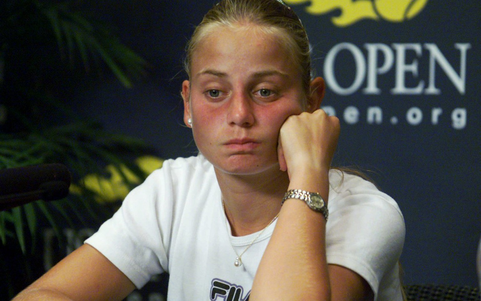 FILE - In this Aug. 31, 2000, file photo, Australia's Jelena Dokic reacts during a news conference at the U.S. Open tennis tournament in New York. Former Wimbledon semifinalist Jelena Dokic says her father physically, verbally and emotionally abused her from a young age when she started playing tennis. In an autobiography to be released this week, the 34-year-old Dokic says that Damir Dokic, who also was her coach, regularly beat her, pulled her hair and ears, kicked her and even spat in her face. (AP Photo/Ed Betz)