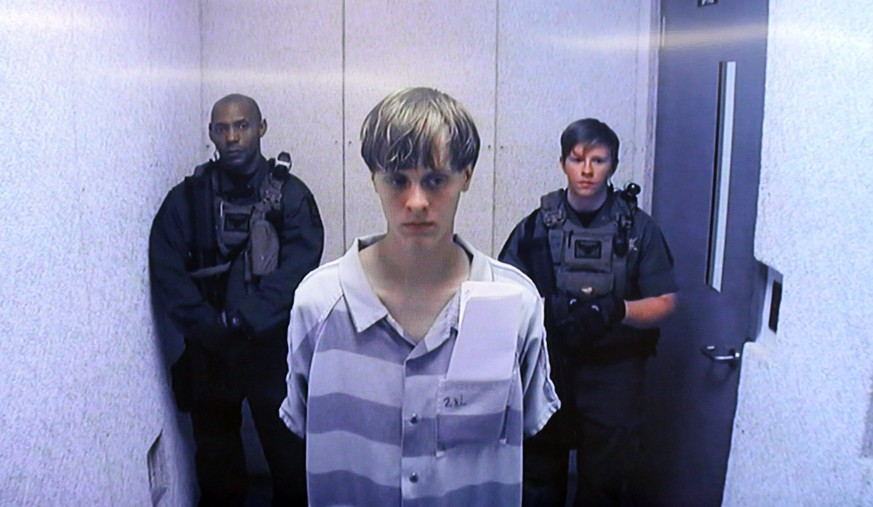 epa05621082 (FILE) A file picture dated 19 June 2015 shows suspect Dylann Roof (C) appears via video link at a bond hearing in court in North Charleston, South Carolina, USA. On 07 November 2016 in Charleston, USA, the final phase for the selection of the jury in Roof's trial has started. Roof is indicted on 33 federal counts of hate crimes, obstruction of religion and using a firearm in a violent crime after he opened fire during a Bible study session at Emanuel African Methodist Episcopal Church in Charleston in June 2015.  EPA/GRACE BEAHM/POOL *** Local Caption *** 52015942