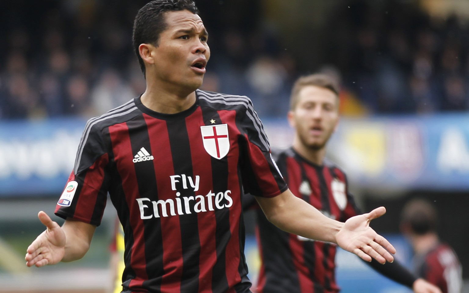 AC Milan's Carlos Bacca gestures during a Serie A soccer match against Chievo at Bentegodi stadium in Verona, Italy, Sunday, March 13, 2016. (AP Photo/Felice Calabro')