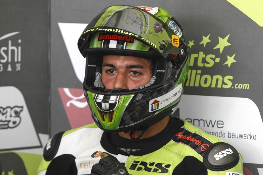 Moto2 rider Jesko Raffin of Switzerland sits in his pit garage during the third free practice session ahead of Sunday's Malaysian Motorcycle Grand Prix in Sepang, Malaysia, Saturday, Oct. 24, 2015. (AP Photo/Joshua Paul)