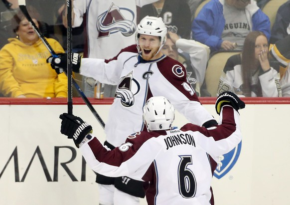 Oct 17, 2016; Pittsburgh, PA, USA;  Colorado Avalanche left wing Gabriel Landeskog (92) celebrates his game winning goal with defenseman Erik Johnson (6) against the Pittsburgh Penguins in overtime at the PPG Paints Arena. Colorado won 4-3 in overtime. Mandatory Credit: Charles LeClaire-USA TODAY Sports