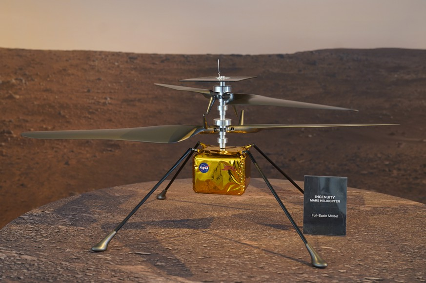 FILE - This Wednesday, Feb. 17, 2021 file photo shows a full-scale model of the Ingenuity helicopter displayed for the media at NASA's Jet Propulsion Laboratory in Pasadena, Calif. The 4-pound (1.8-kilogram) helicopter, named Ingenuity, will attempt to rise 10 feet (3 meters) into the extremely thin Martian air on its first hop. Five increasingly higher and longer flights are planned over the course of a month. (AP Photo/Damian Dovarganes) Mars Helicopter Ingenuity
