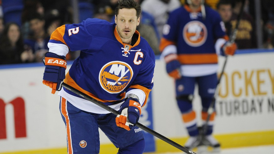New York Islanders defenseman Mark Streit (2) skates towards a puck during practice before the NHL hockey game against the Pittsburgh Penguins on Friday, March 22, 2013 at Nassau Coliseum  in Uniondale, N.Y. (AP Photo/Kathy Kmonicek)