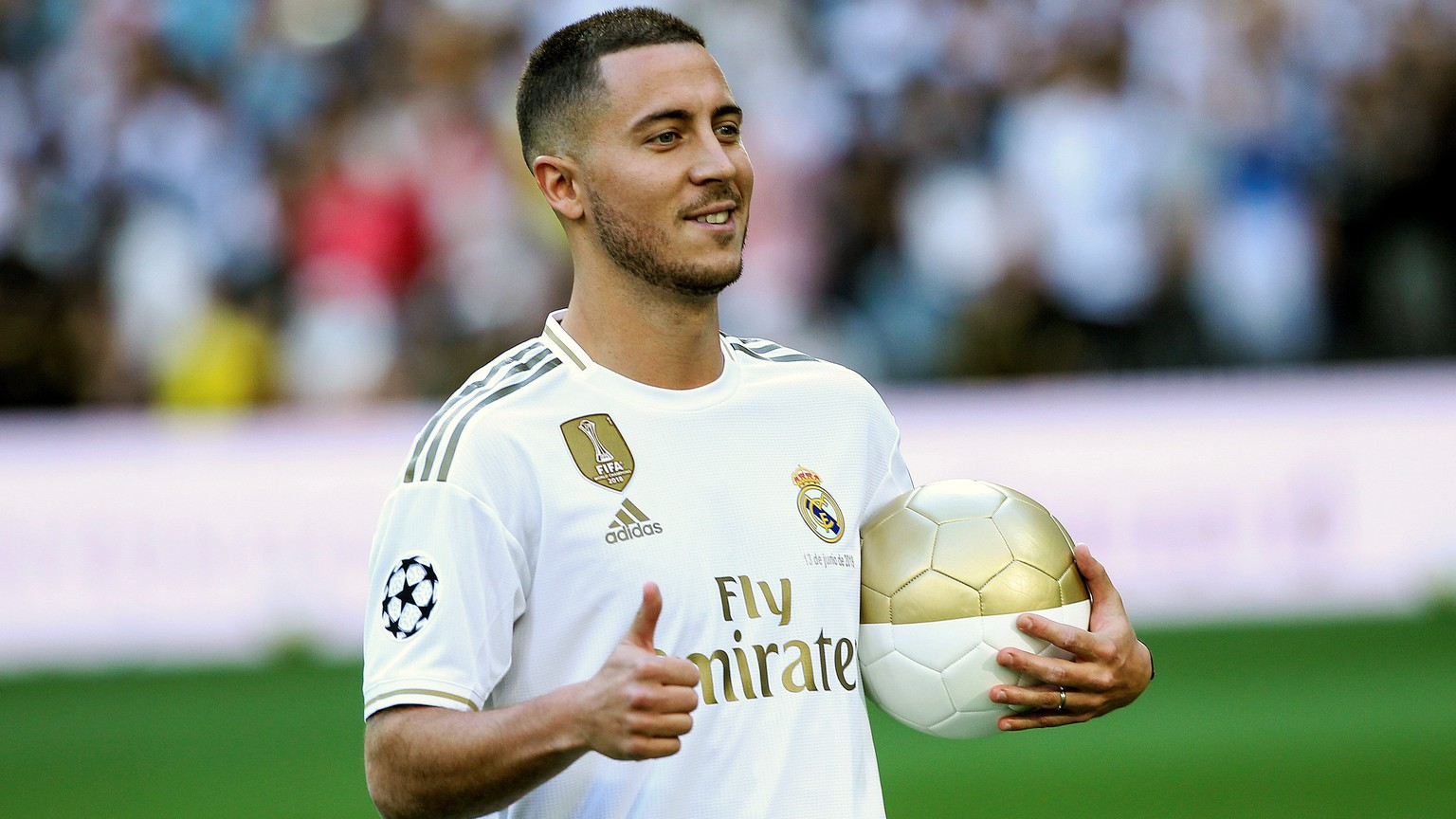 epa07646259 Real Madrid's new soccer player Eden Hazard poses for the photographers during his presentation at Santiago Bernabeu stadium in Madrid, Spain, 12 June 2019. Belgian Eden Hazard has signed a five-seasons-contract with Real Madrid after Spanish LaLiga's club Real Madrid reached an agreement with Chelsea FC for his transfer for 100 million euro plus 30 on variables.  EPA/Rodrigo Jimenez