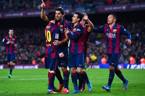 BARCELONA, SPAIN - FEBRUARY 15:  Luis Suarez of FC Barcelona celebrates with his teammates after scoring his team's fifth goal during the La Liga match between FC Barcelona and Levante UD at Camp Nou on February 15, 2015 in Barcelona, Spain.  (Photo by David Ramos/Getty Images )