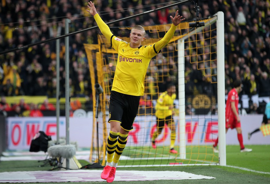 epa08185042 Dortmund's Erling Haaland celebrates after scoring during the German Bundesliga soccer match between Borussia Dortmund and 1. FC Union Berlin in Dortmund, Germany, 01 February 2020.  EPA/FRIEDEMANN VOGEL CONDITIONS - ATTENTION: The DFL regulations prohibit any use of photographs as image sequences and/or quasi-video.