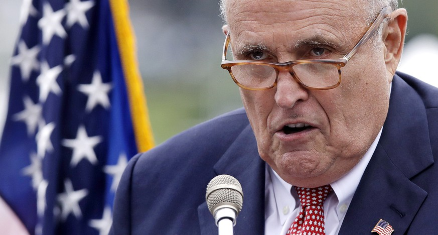 FILE - This Aug. 1, 2018, file photo shows Rudy Giuliani, an attorney for President Donald Trump, in Portsmouth, N.H. As Giuliani was pushing Ukrainian officials in the spring of 2019 to investigate one of Donald Trump's main political rivals, a group of individuals with ties to the president and his personal lawyer were also active in the former Soviet Republic. (AP Photo/Charles Krupa, File) Rudy Giuliani