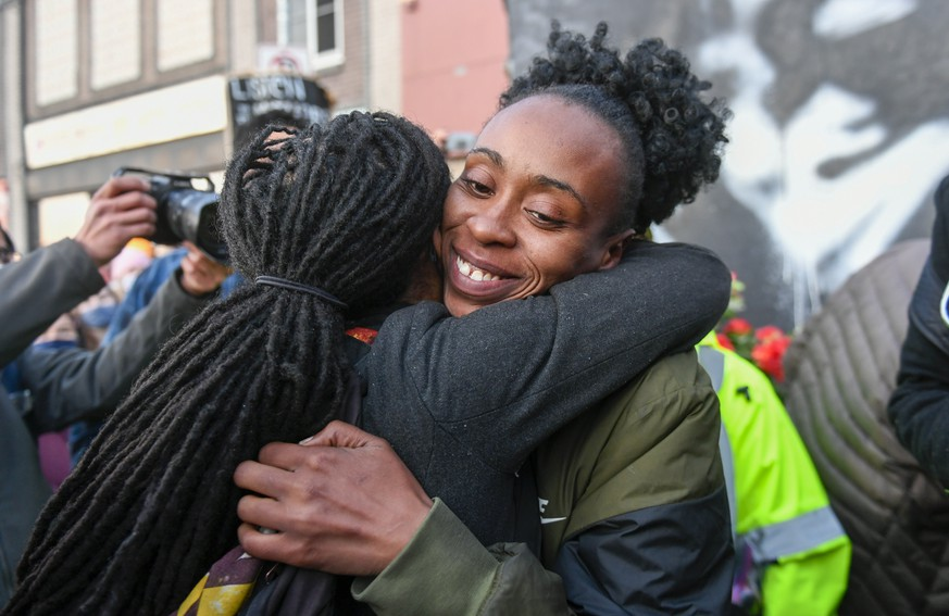 epa09148739 Community organizer Malisha Smith (R) hugs a friend as people celebrate at the George Floyd Square after former Minneapolis Police Officer Derek Chauvin was found guilty on all counts in the death of George Floyd in Minneapolis, Minnesota, USA, 20 April 2021. Chauvin was found guilty on charges of second-degree murder, third-degree murder and second-degree manslaughter.  EPA/CRAIG LASSIG