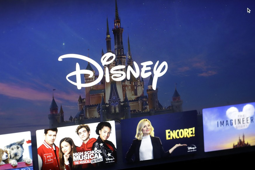 FILE - In this Wednesday, Nov. 13, 2019 file photo, a Disney logo forms part of a menu for the Disney Plus movie and entertainment streaming service on a computer screen in Walpole, Mass.   Analysts predict the entertainment giant's fiscal first-quarter earnings declined from a year earlier, even as revenue increased. Investors will be listening for an update on the company's video streaming service, which launched in November. Disney serves up its results Tuesday, Feb. 4, 2020.  (AP Photo/Steven Senne, File) Elizabeth Warren