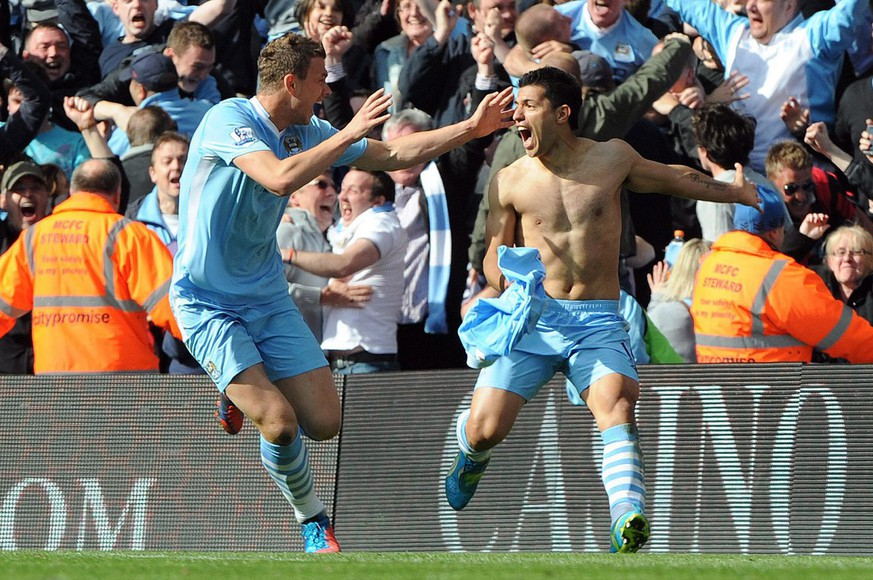 epa03217905 Manchester City's Sergio Aguero celebrates scoring the winning goal during the English Premier League soccer match at Etihad Stadium Manchester, Britain, 13 May 2012. ..DataCo terms and conditions apply. http//www.epa.eu/downloads/DataCo-TCs.pdf  EPA/PETER POWELL DataCo terms and conditions apply. http//www.epa.eu/downloads/DataCo-TCs.pdf