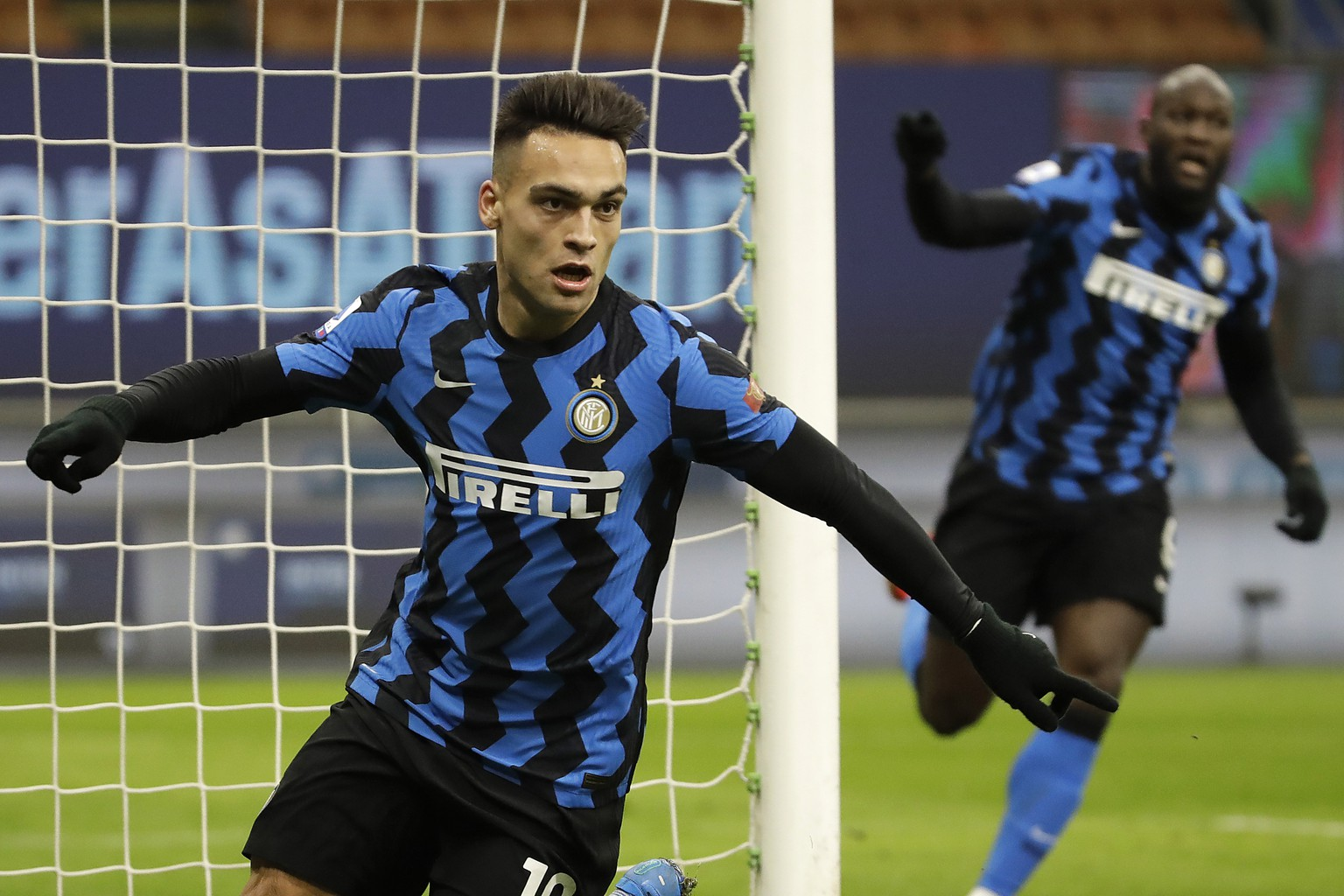 Inter Milan's Lautaro Martinez celebrates his goal against Lazio during a Serie A soccer match between Inter Milan and Lazio at the San Siro stadium in Milan, Italy, Sunday, Feb. 14, 2021. (AP Photo/Luca Bruno)