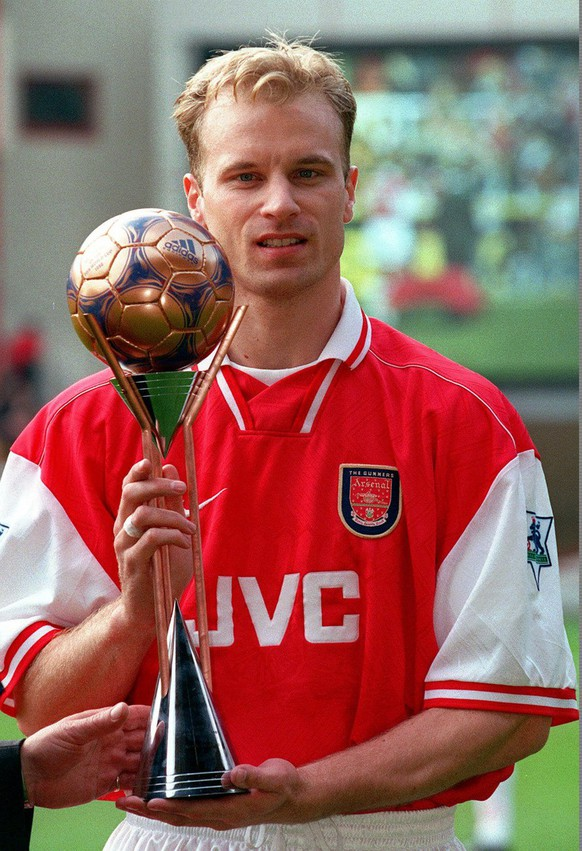 Arsenal's Dutchman Dennis Bergkamp displays the third-place World Player of the Year trophy at Arsenal's Highbury Stadium in London in this March 28, 1998 photo. (AP Photo/Adrian Dennis)