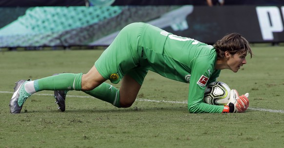 Borussia Dortmund goalkeeper Marwin Hitz stops a shot against Liverpool during the second half of an International Champions Cup tournament soccer match in Charlotte, N.C., Sunday, July 22, 2018. (AP Photo/Chuck Burton)