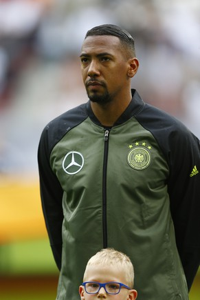 Germany's Jerome Boateng listens to the national anthems prior to the friendly soccer match between Germany and Slovakia in Augsburg, Germany,  Sunday, May 29, 2016. A top member of a rising German nationalist party has drawn sharp criticism for reportedly saying that many people wouldn't want Jerome Boateng, a Germany national soccer team player whose father was born in Ghana, as their neighbor. Alexander Gauland was quoted as telling the Frankfurter Allgemeine Sonntagszeitung newspaper: