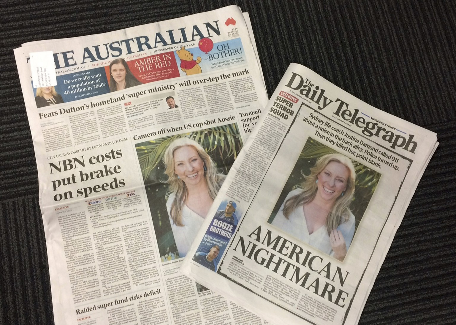 Front pages of two Australian newspapers on Tuesday, July 18, 2017, featuring photos and story of the shooting death of Australia's Justine Damond who was shot dead by a Minneapolis police officer on Saturday. Australia's airwaves, newspapers and websites have been dominated by the news of Damond's death which has stunned many in her native Australia and fed into Australians' darkest fears about America's culture of gun violence. (AP Photo/Kristen Gelineau)