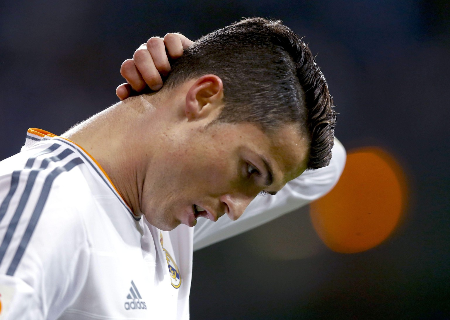 Real Madrid´s Portuguese forward Cristiano Ronaldo reacts during his Spanish King's Cup quarterfinals second leg soccer match against RCD Espanyol played at Santiago Bernabeu stadium in Madrid, Spain, 28 January 2014.  EPA/Juanjo Martin
