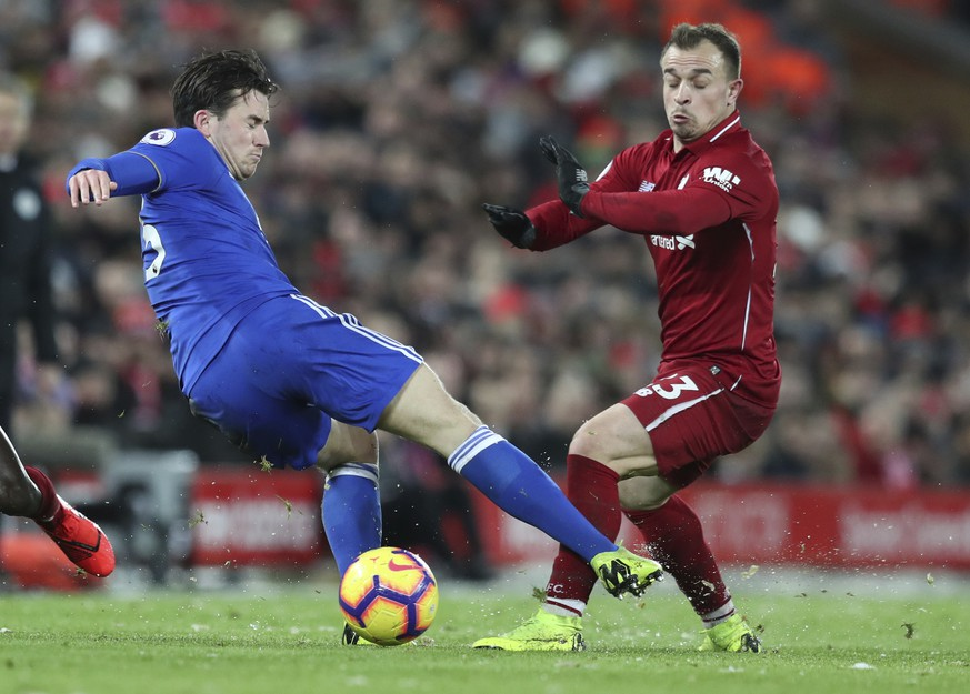Leicester City defender Ben Chilwell, left, challenges for the ball with Liverpool midfielder Xherdan Shaqiri, during the English Premier League soccer match between Liverpool and Leicester City, at Anfield Stadium, Liverpool, England, Wednesday, Jan.29, 2019. (AP Photo/Jon Super)