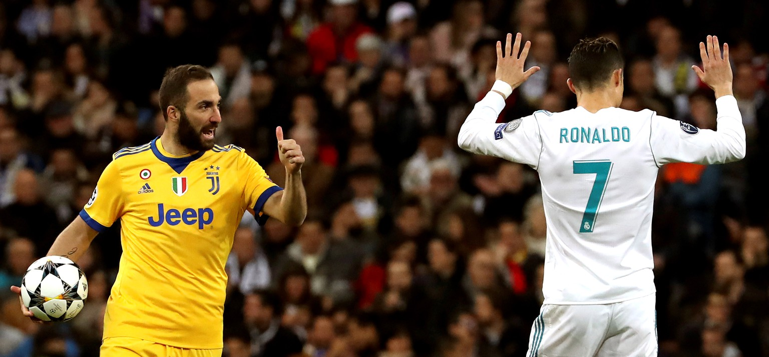 epa06864135 (FILE) Juventus' Gonzalo Higuain (L) and Real Madrid's Cristiano Ronaldo (R) react during the UEFA Champions League quarter final, second leg soccer match between Real Madrid and Juventus at Santiago Bernabeu stadium in Madrid, Spain, 11 April 2018 (reissued on 04 July 2018). According to reports on 04 July 2018 Juventus are in advanced talks to sign Cristiano Ronaldo.  EPA/KIKO HUESCA