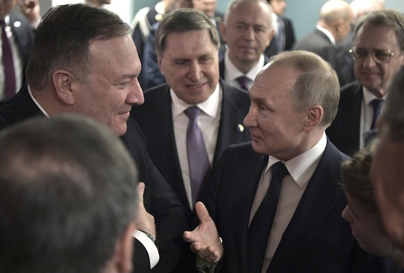 epa08141943 US Secretary of State Mike Pompeo (L) speaks with Russian President Vladimir Putin (2nd-R) during the International Libya Conference in Berlin, Germany, 19 January 2020. By means of the 'Berlin Process', German government seeks to support the peace efforts of the United Nations (UN) to bring about an end to the conflict in Libya. Following the renewed outbreak of hostilities in April 2019, UN presented a plan to stop further military escalation and resume an intra-Libyan process of reconciliation.  EPA/ALEXEI NIKOLSKY/SPUTNIK/KREMLIN POOL / POOL MANDATORY CREDIT