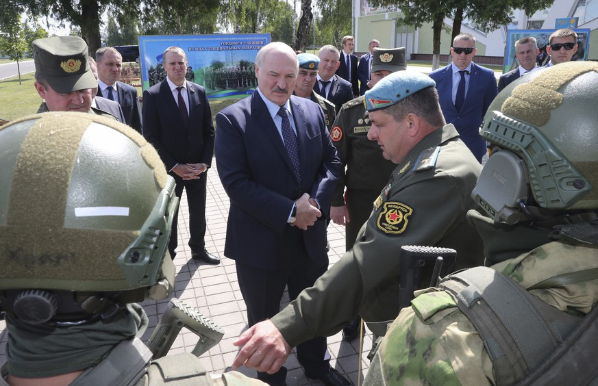 Belarusian President Alexander Lukashenko, centre, inspects equipment and weapons of Belarusian army special troops as he visits the military base in the town of Maryina Gorka, 60 kilometers (37 miles) southeast of Minsk, Belarus, Friday, July 24, 2020. Alexander Lukashenko warned Thursday that Western media could be expelled from the country over what he described as their