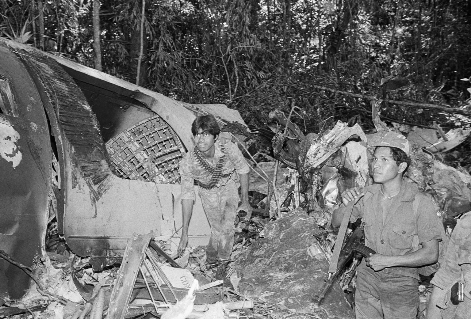 Wreckage of the rebel supply plane shot down on Saturday, Jan. 24, 1988 over Nicaragua lies in a jungle-covered area near the village of El Arenla. The plane was shot down by Sandinista forces after it had ari-dropped supplies to Contra rebels, according to authorities. (AP Photo/Mario Tapia)