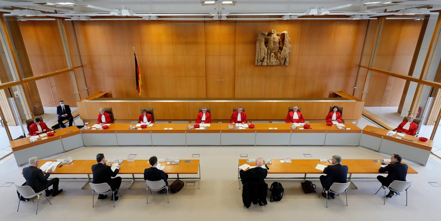 epa08474137 (L-R, back) The members of the second senate of the German Federal Constitutional Court, justices Christine Langenfeld, Doris Koenig, Monika Hermanns, Peter Mueller, presiding judge Andreas Vosskuhle, Peter M. Huber, Sibylle Kessal-Wulf and Ulrich Maidowskie, listen to arguments on a complaint by the far-right Alternative for Germany (AfD) party against German Interior Minister Horst Seehofer at the Federal Constitutional Court in Karlsruhe, Germany, 09 June 2020. The court has ruled that Seehofer violated the neutrality of his office and infringed the principle of equality of opportunity after saying in an interview that the AfD was 'corrosive for the state.' The interview was published on the interior ministry's homepage for around two weeks. The AfD brought the case to the highest court, accusing Seehofer of having unlawfully used state resources to spread a party-political message.  EPA/RONALD WITTEK
