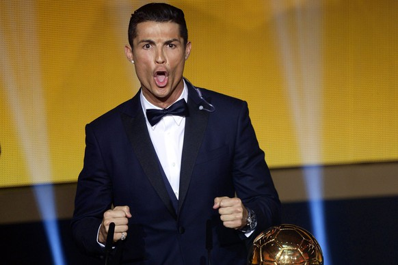 epaselect epa04557535 Portuguese striker Cristiano Ronaldo reacts after receiving the FIFA Ballon D'or World Player of the Year 2014 award during the FIFA Ballon d'Or 2014 gala held at the Kongresshaus in Zurich, Switzerland, 12 January 2015.  EPA/WALTER BIERI