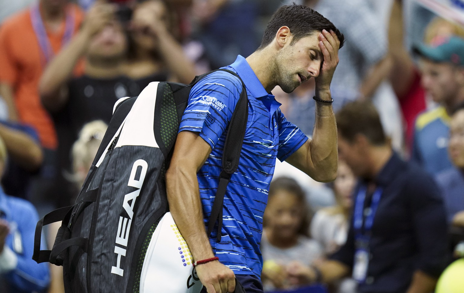 Novak Djokovic, of Serbia, walks off the court as he retires during his match against Stan Wawrinka, of Switzerland, during the fourth round of the U.S. Open tennis championships, Sunday, Sept. 1, 2019, in New York. (AP Photo/Eduardo Munoz Alvarez)