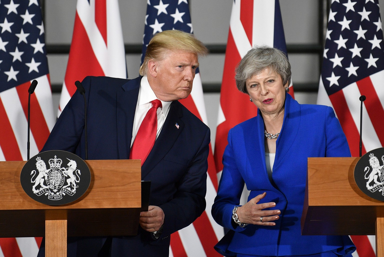epa07624939 US President Donald J. Trump (L) and Britain's Prime Minister Theresa May (R) speak at a press conference at the Foreign and Commonwealth Office in London, Britain, 04 June 2019. US President Trump and his wife are on a three-day official visit to Britain.  EPA/NEIL HALL