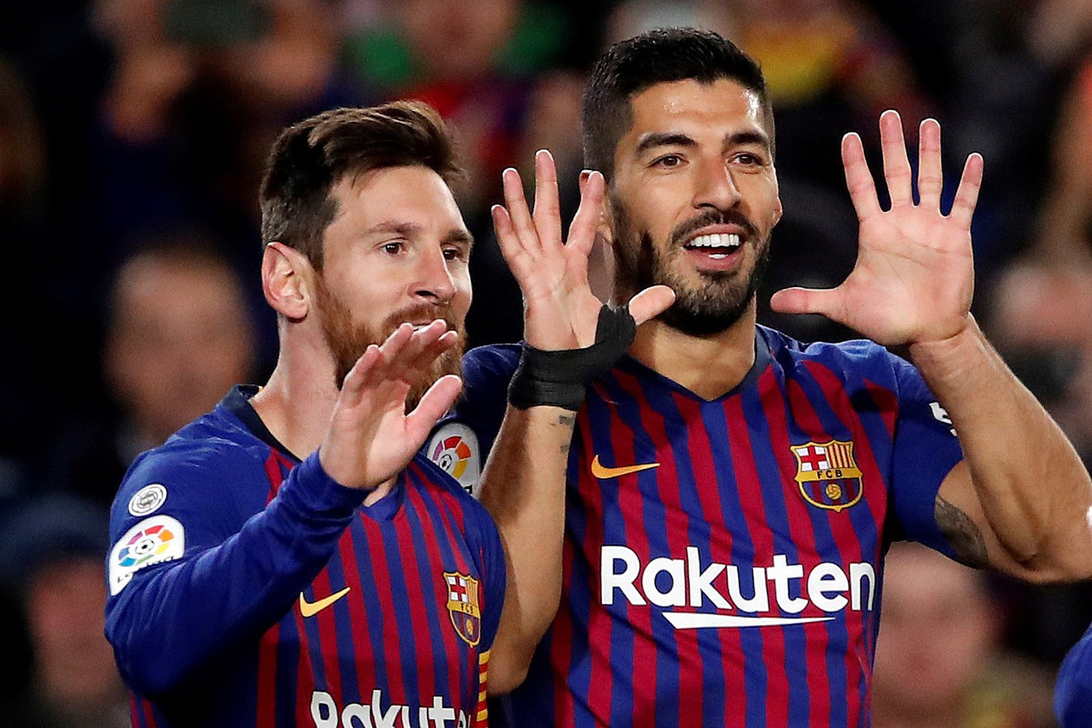 epa07280678 FC Barcelona's Luis Suarez (R) celebrates with teammate Lionel Messi (L) after scoring the 3-0 lead during the Spanish La Liga Primera Division soccer match between FC Barcelona and SD Eibar at Camp Nou stadium in Barcelona, Spain, 13 January 2019.  EPA/ALBERTO ESTEVEZ