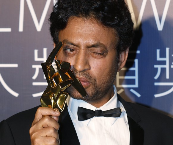Indian actor Irrfan Khan celebrates after winning the Best Actor for his movie