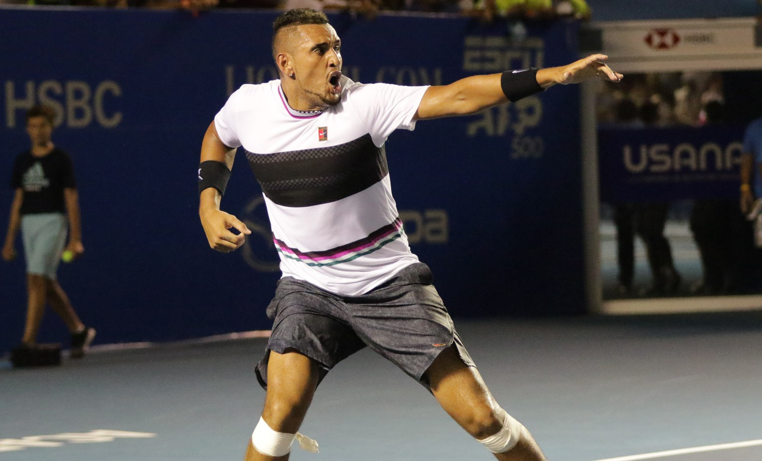 epa07403070 Nick Kyrgios of Australia celebrates his win against Rafael Nadal of Spain in their Mexico Tennis Open round of 16 match held in Acapulco, Mexico, 27 February 2019.  EPA/David Guzman