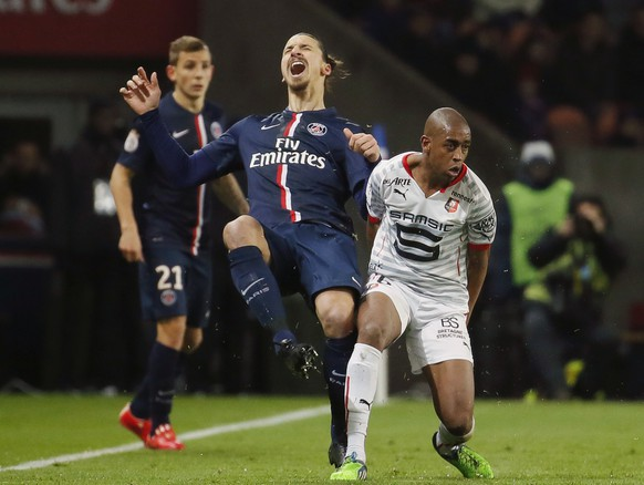 Paris St Germain's Zlatan Ibrahimovic (L) reacts next to Stade Rennes' Gelson Fernandes during their French Ligue 1 soccer match at Parc des Princes stadium in Paris January 30, 2015. REUTERS/Gonzalo Fuentes (FRANCE - Tags: SPORT SOCCER TPX IMAGES OF THE DAY)