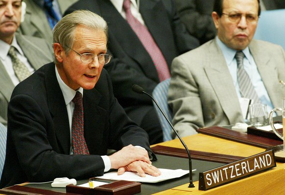 Iraq's U.N. Ambassador Mohammed Al-Douri, right, listens as Switzerland's Ambassador Jeno Staehelin speaks at a meeting of the Security Council at the United Nations Tuesday, March 11, 2003. (AP Photo/Stuart Ramson)