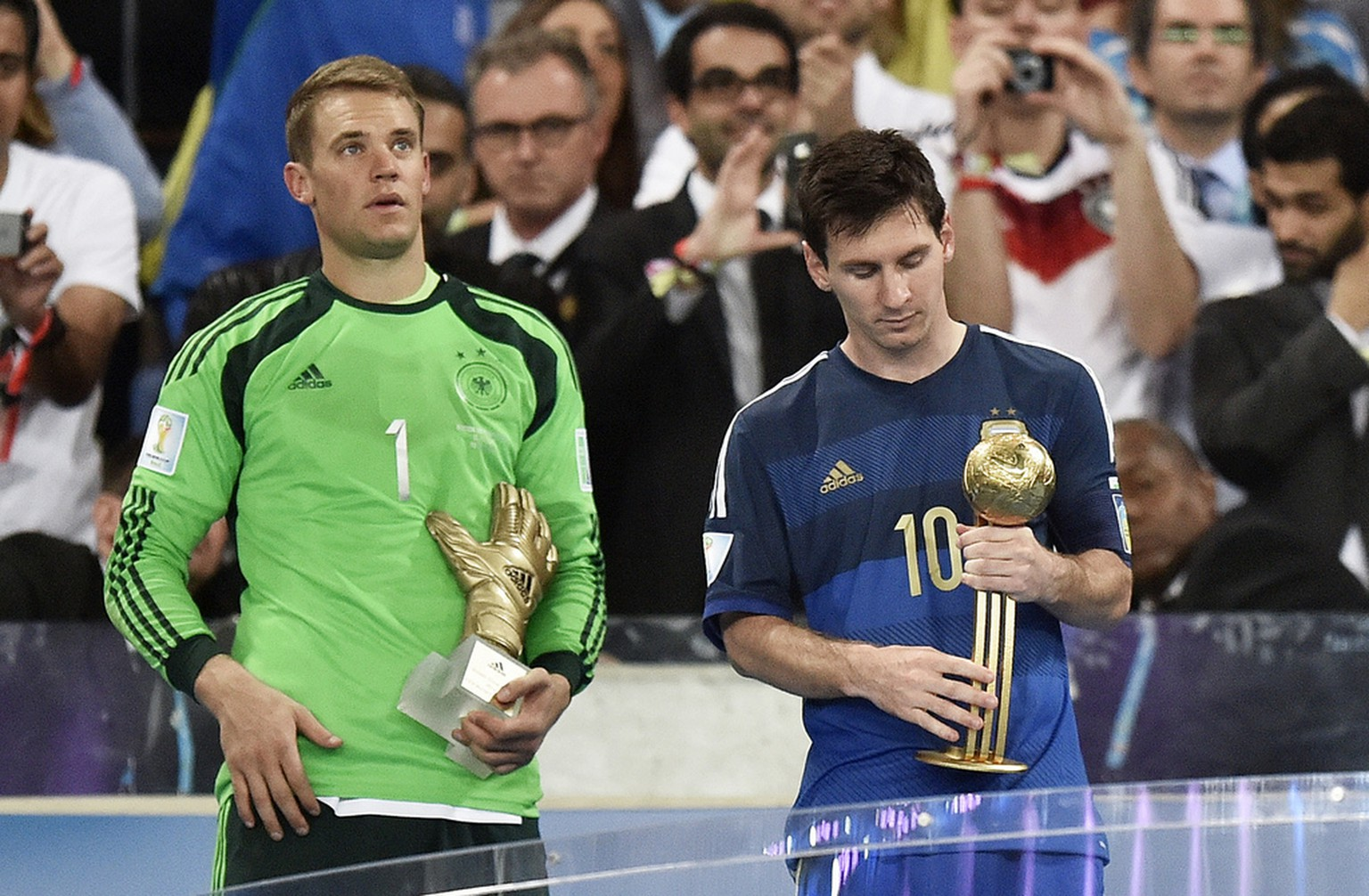 Germany's goalkeeper Manuel Neuer, left, winner of the Golden Glove award for best goalkeeper, stands with Argentina's Lionel Messi, right, winner of the Golden Ball award as the tournament's top player, after the World Cup final soccer match between Germany and Argentina at the Maracana Stadium in Rio de Janeiro, Brazil, Sunday, July 13, 2014. Germany won the match 1-0. (AP Photo/Martin Meissner)