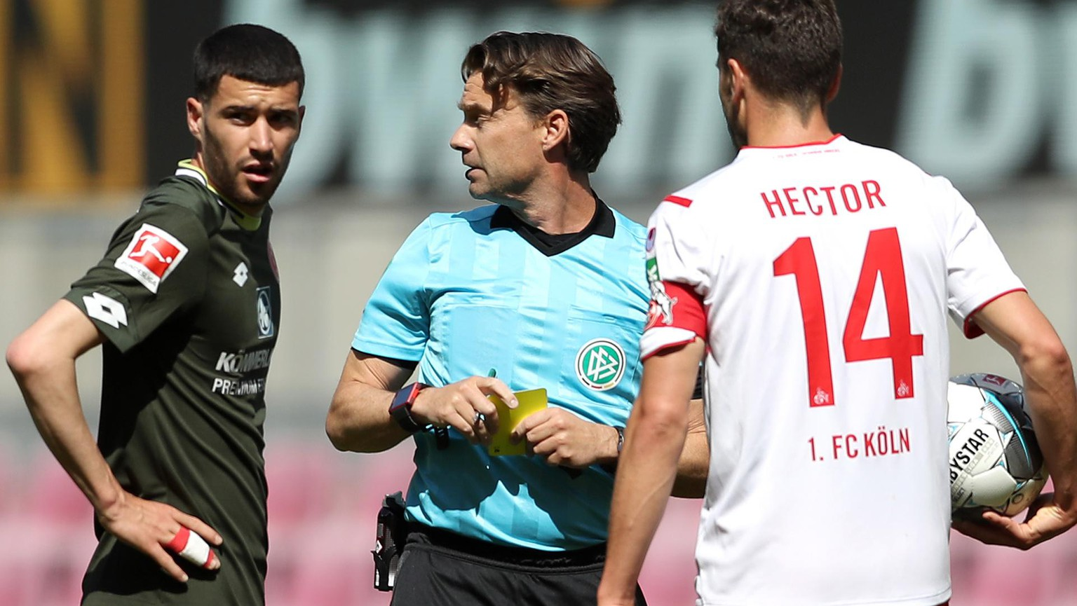 epa08427903 Referee Guido Winkmann discusses with Jonas Hector (R) of 1. FC Koeln during the German Bundesliga soccer match between 1. FC Koeln and 1. FSV Mainz 05 at RheinEnergieStadion in Cologne, Germany, 17 May 2020.  The German Bundesliga and Bundesliga Second Division are the first professional leagues to resume the season after the nationwide lockdown due to the ongoing Coronavirus (COVID-19) pandemic. All matches until the end of the season will be played behind closed doors.  EPA/LARS BARON / POOL DFL regulations prohibit any use of photographs as image sequences and/or quasi-video.