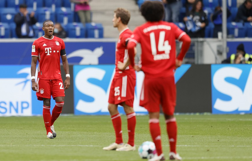 epa08701479 Bayern's David Alaba (L) reacts during the German Bundesliga soccer match between TSG 1899 Hoffenheim and FC Bayern Munich in Sinsheim, Germany, 27 September 2020.  EPA/RONALD WITTEK CONDITIONS - ATTENTION: The DFL regulations prohibit any use of photographs as image sequences and/or quasi-video.